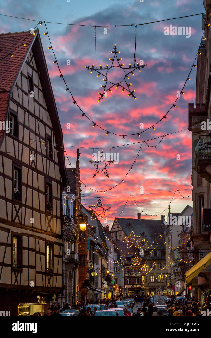 """Christmas Star in front of pink dusk clouds at the Christmas market in Colmar, France<a href=""""http://de.wikipedia.org/wiki/Colmar"""" Stock Photo"""
