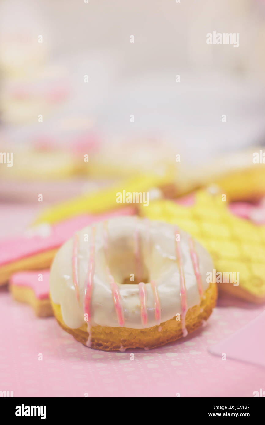 First birthday cookies - cookies and white decorated doughnut, with copy space - Stock Image