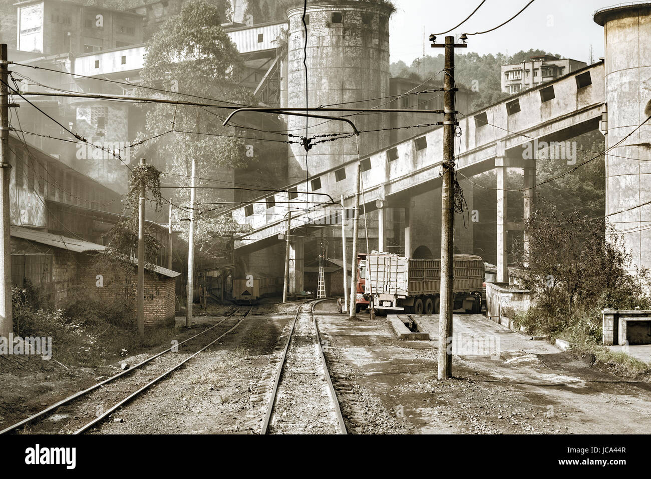 Narrow-gauge railway and trucks by the coal loading point. Jiayang Mining Region. Sichuan province. China. Stock Photo