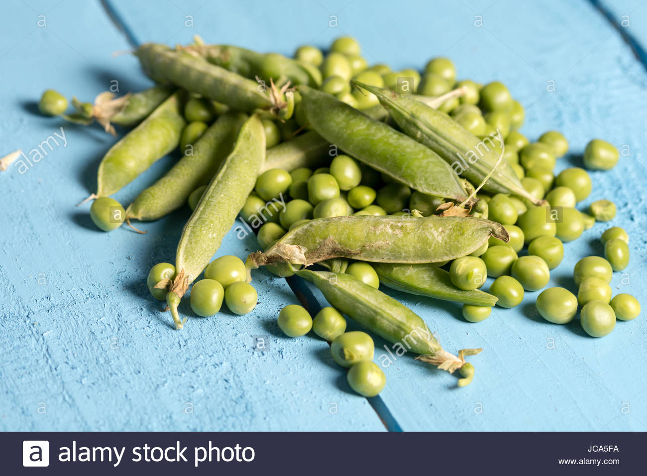Pile of fresh green peas closeup macro view above. - Stock Image