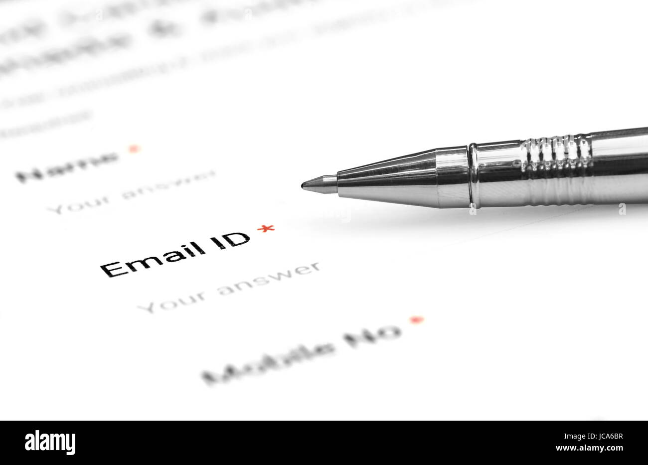 Filing a form with e mail ID with ballpoint - Stock Image