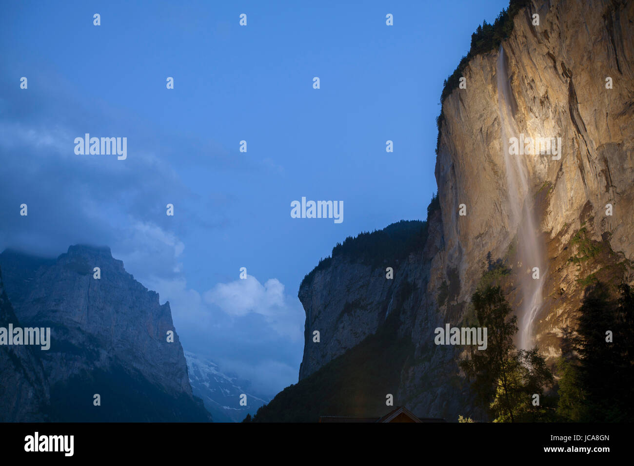 A waterfall at night in the Lauterbrunnen valley of Switzerland. - Stock Image