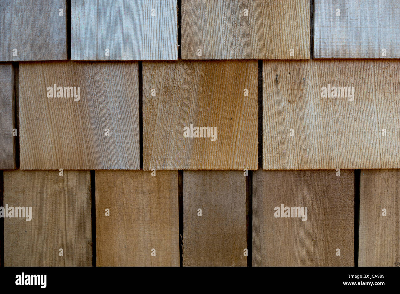 Cedar shakes on the side of a house - Stock Image