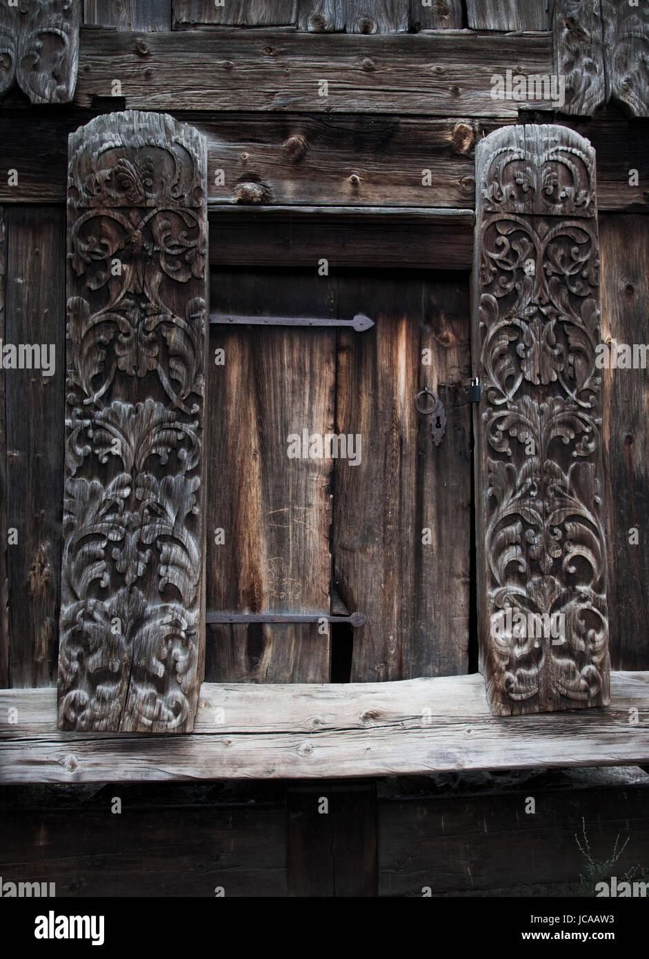 Carved wooden doorway at Skansen Open Air Museum, Stockholm, Sweden - Stock Image