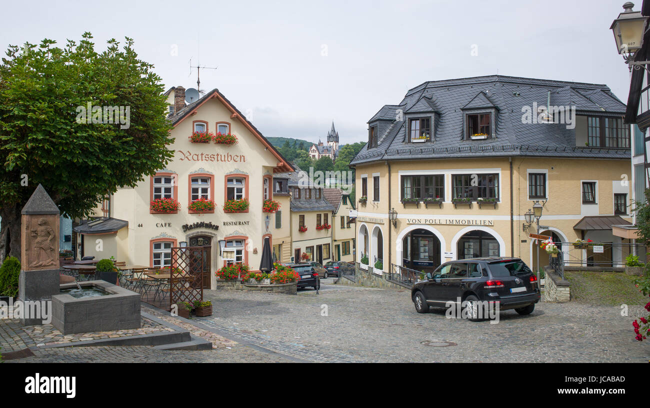 Block paved square at junction of Hauptstrasse, Neugasse, and Gerichtstrasse, with water fountain, restaurant, and - Stock Image