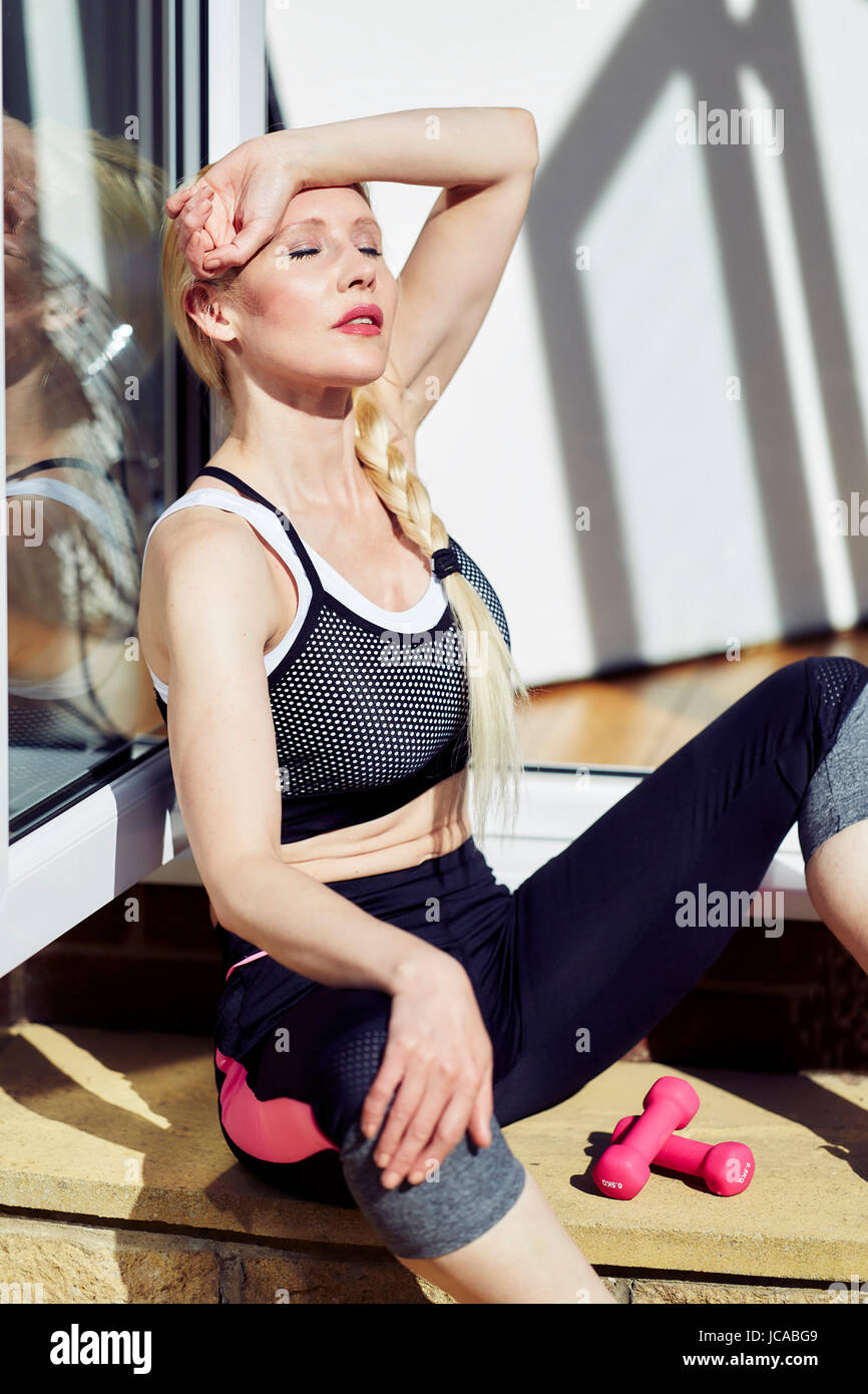 Girl relaxing after working out - Stock Image