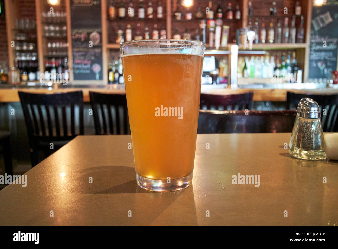pint of cloudy craft beer served in a pub in Boston USA - Stock Image