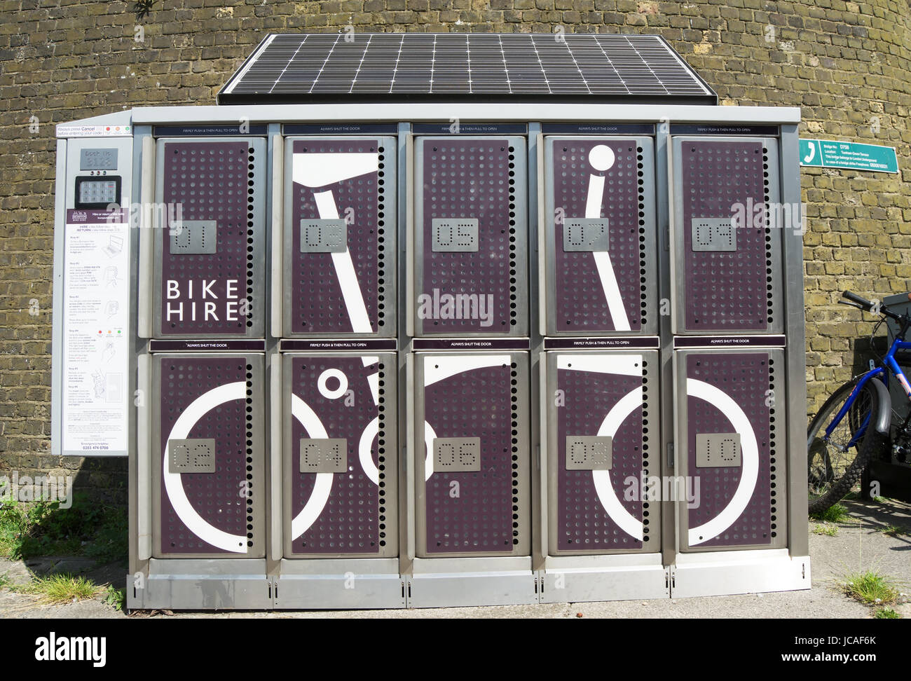 folding bike hire point, chiswick, london, england, with solar panel on top - Stock Image