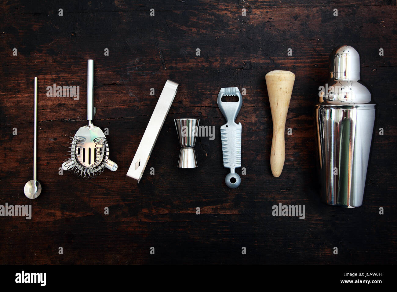 set of bar or pub accessories with a martini cocktail shaker