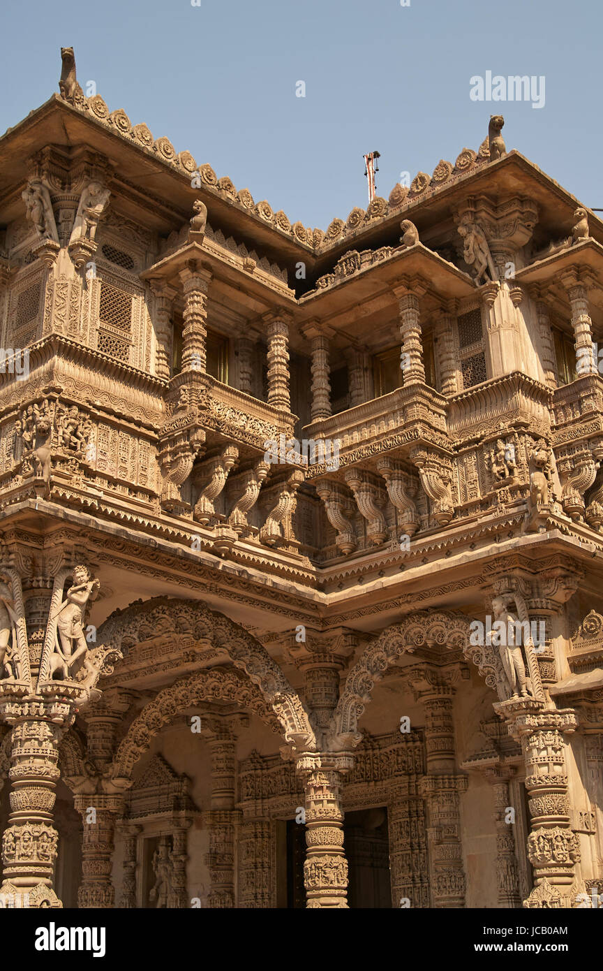 Ornately carved stonework of the entrance to the Hutheesing Temple in Ahmedabad, Gujarat, India. Jain temple built - Stock Image