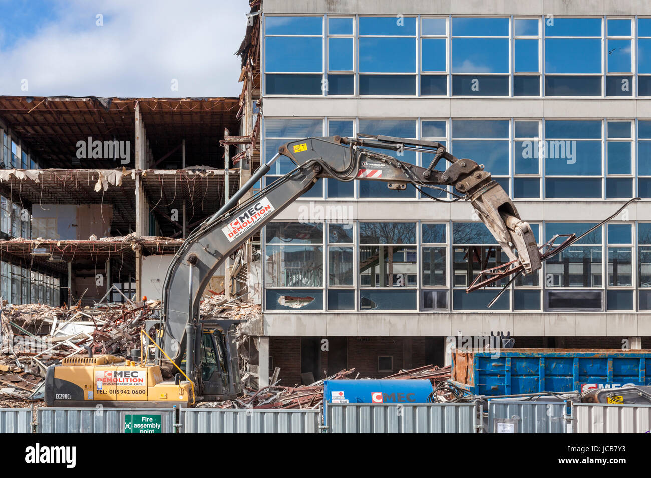 Demolition excavator at work during the demolition of office buildings, Nottinghamshire, England, UK - Stock Image