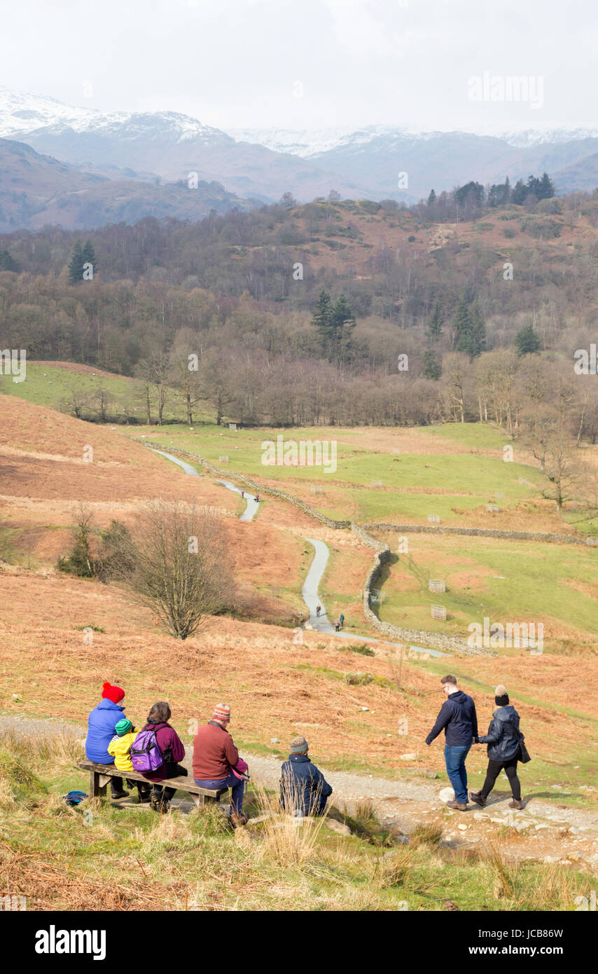 A family looking across Rydal Water near Ambleside, Cumbria, England, UK Stock Photo