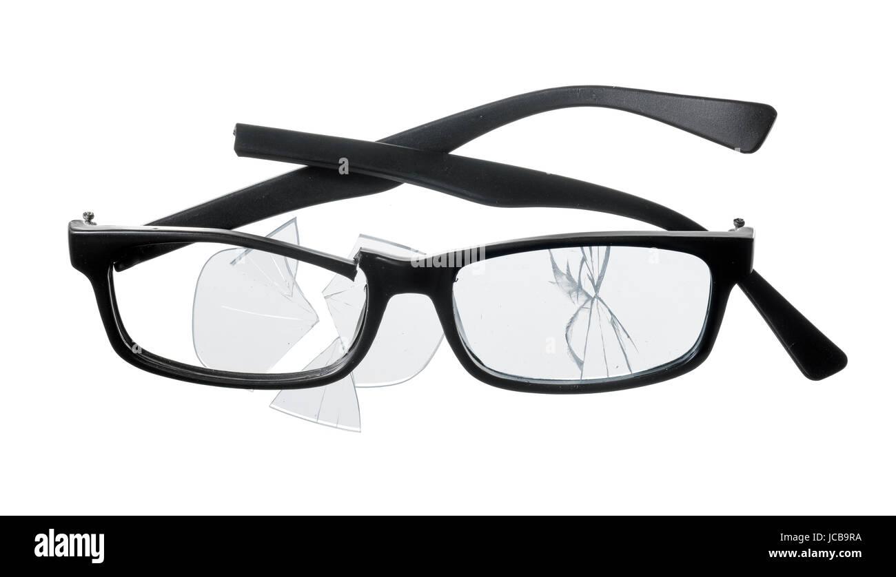 Cheap plastic reading glasses broken on white background. - Stock Image