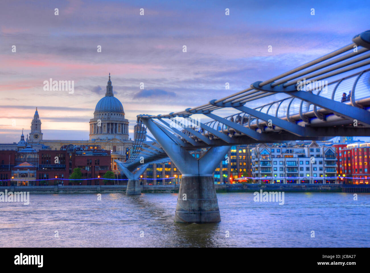 St. Paul's Cathedral from Millennium Footbridge in London, UK - Stock Image