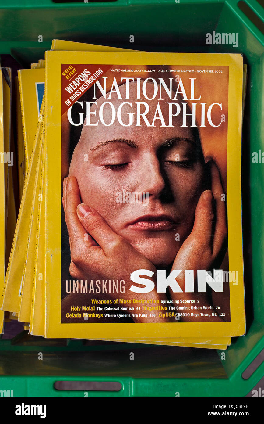 A box of National geographic magazines outside a charity shop in Edinburgh. - Stock Image