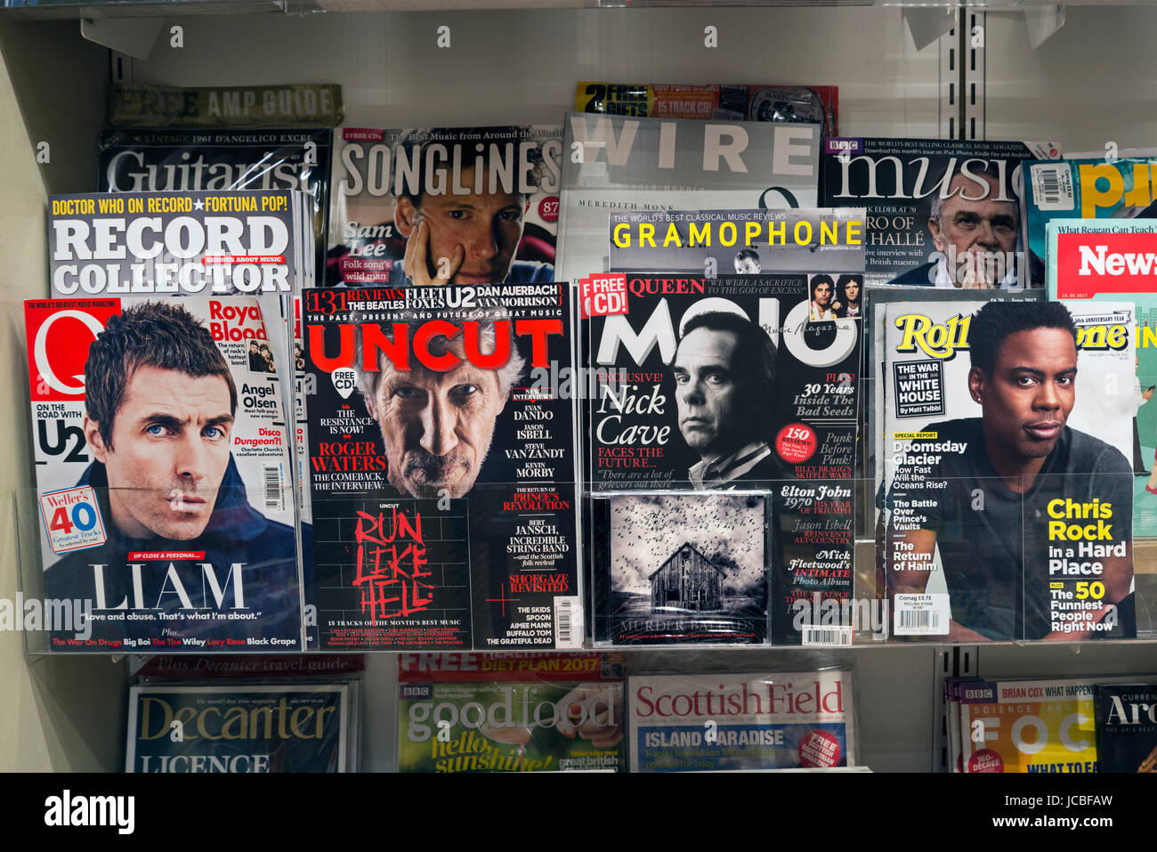 Music magazines on display in a newsagent - Stock Image