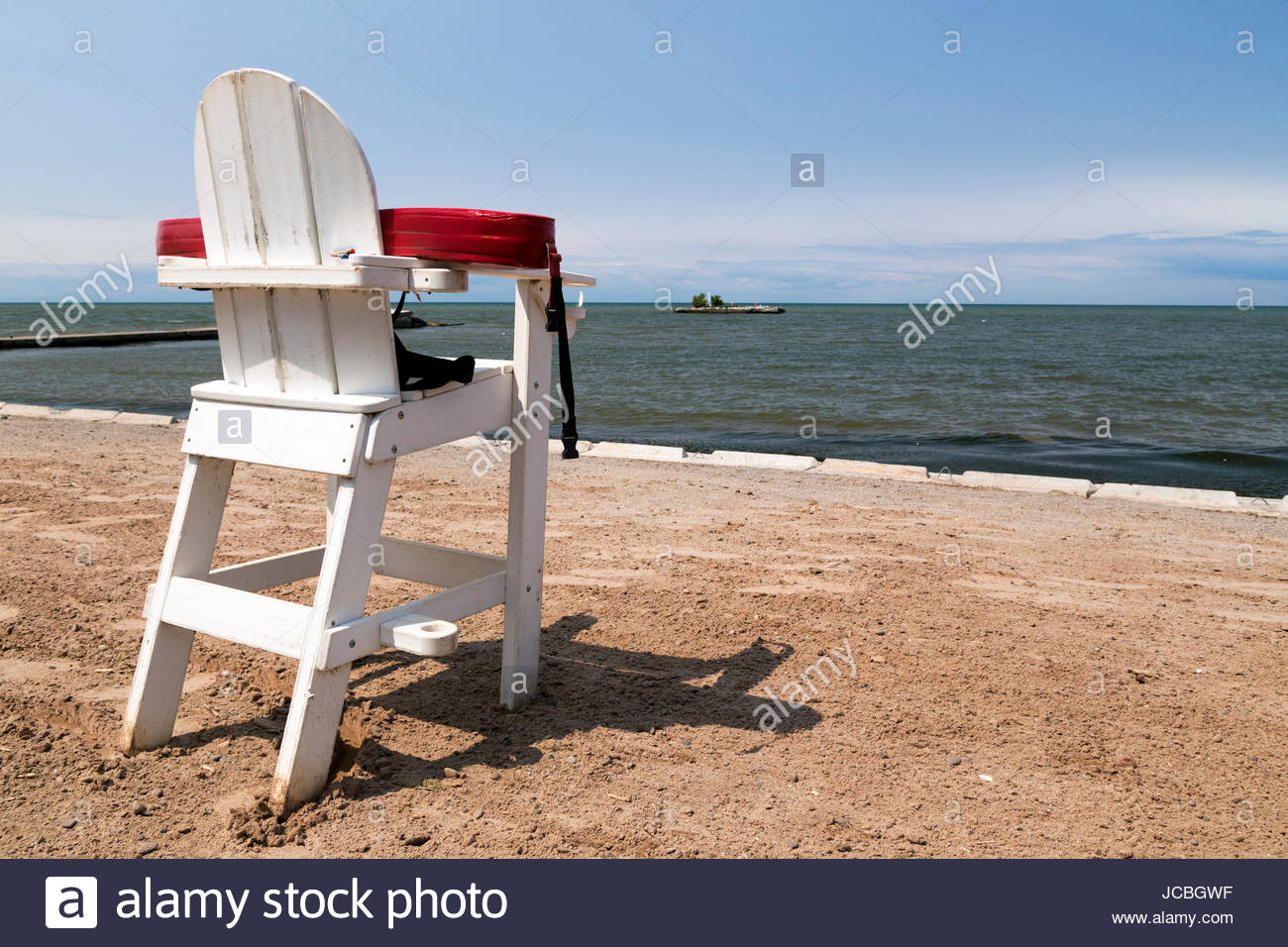 Unmanned White Lifeguard Chair With Floatation Device On An Empty Beach.    Stock Image