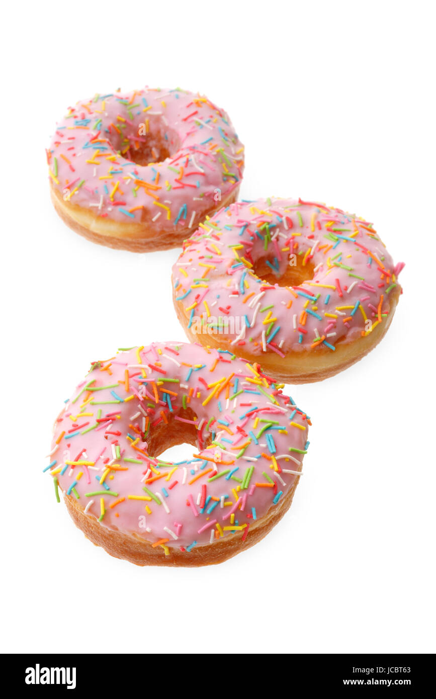 Food and drink: group of pink donuts, isolated on white background - Stock Image