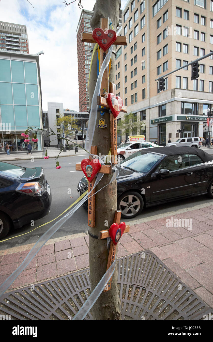 memorials to the boston marathon bombing victims at site of one of the explosions Boston USA - Stock Image