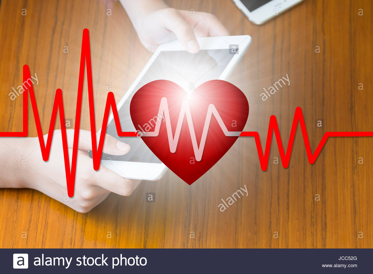 Doctors press tablet, iPad, E-Health concept, health, medicine and heArt and artwork disease concept, health care - Stock Image