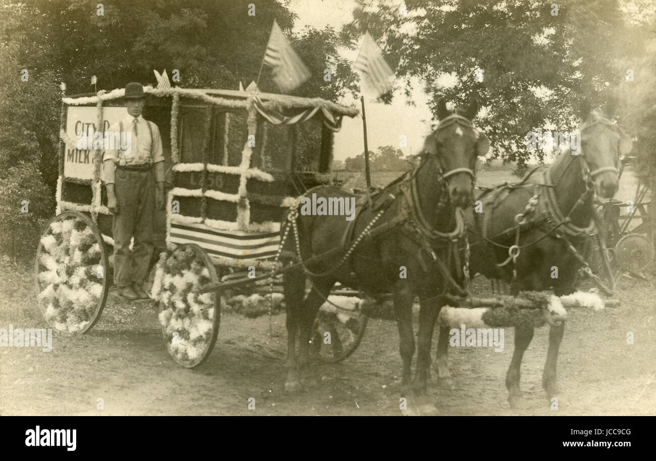 Antique July 5, 1904 photograph, horse and wagon for 'City Dairy Milk & Cream' decorated for the Fourth - Stock Image