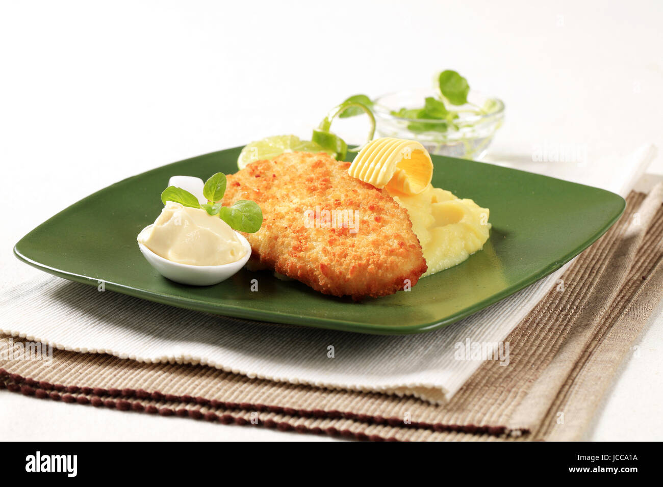 Fried breaded fish served with mashed potato Stock Photo