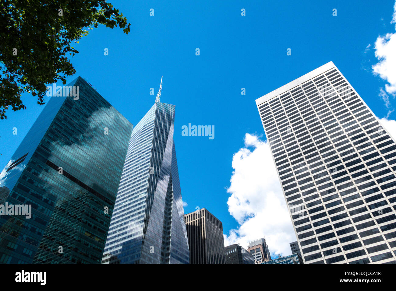 Looking up at the Skyscrapers Surrounding Bryant Park, NYC, USA - Stock Image