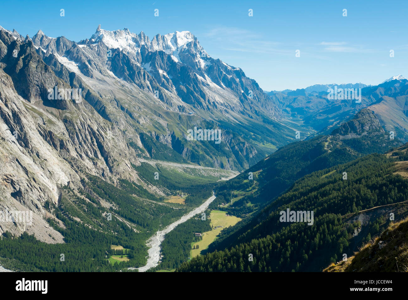 Val Veny valley in Val d'Aosta, in Italy, with Dora di Val Veny river and forests on hillsides. - Stock Image
