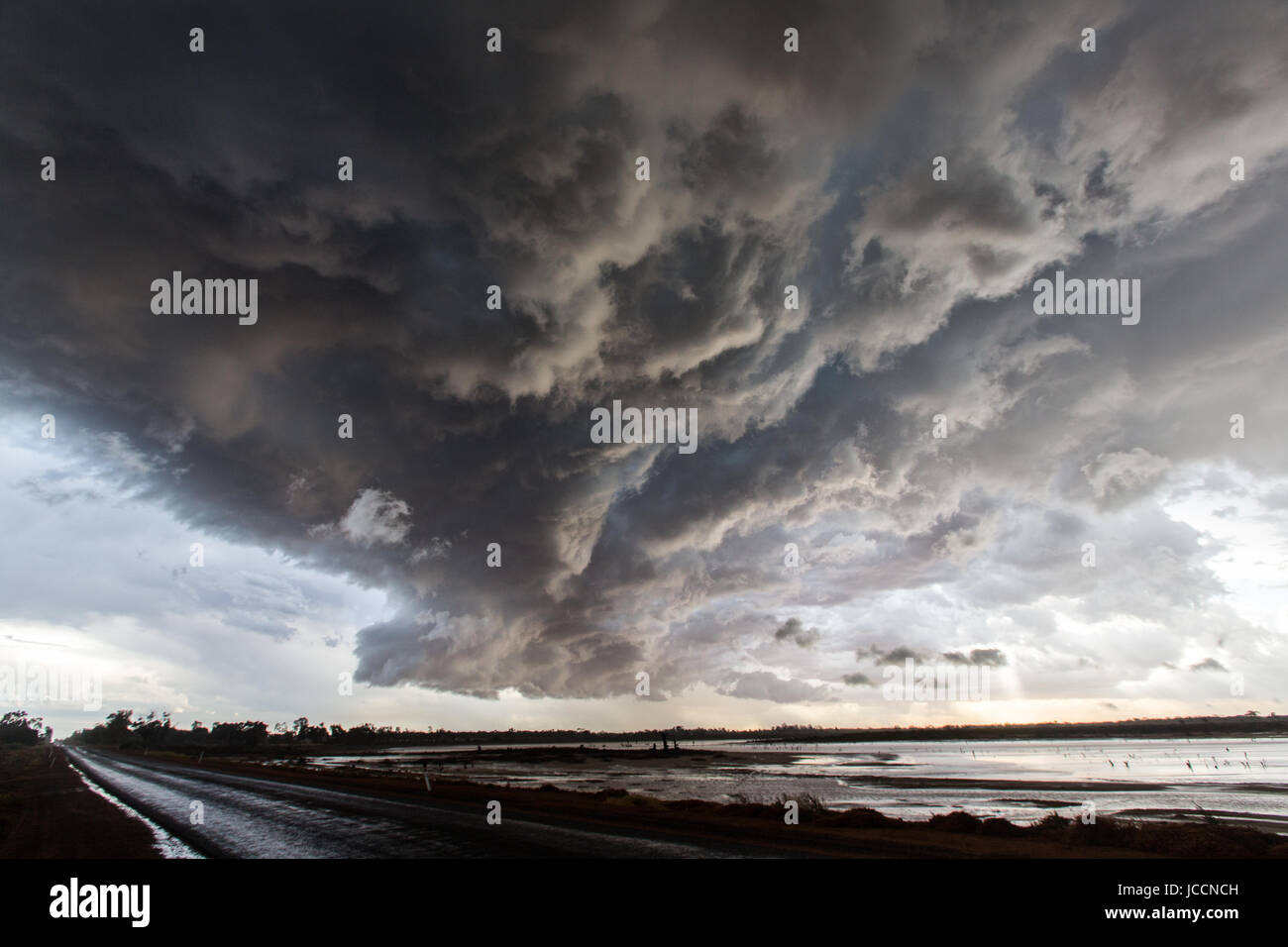 Storm passes over saline lake in the far north of Victoria - Stock Image