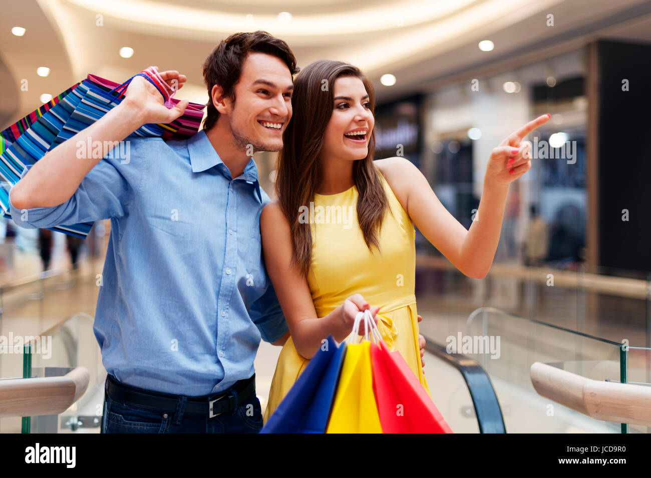 Woman showing something in the shopping mall Stock Photo