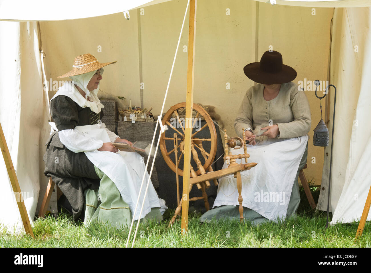 Women spinning yarn in an encampment at a Sealed Knot English Civil war reenactment event. Charlton park, Malmesbury, - Stock Image