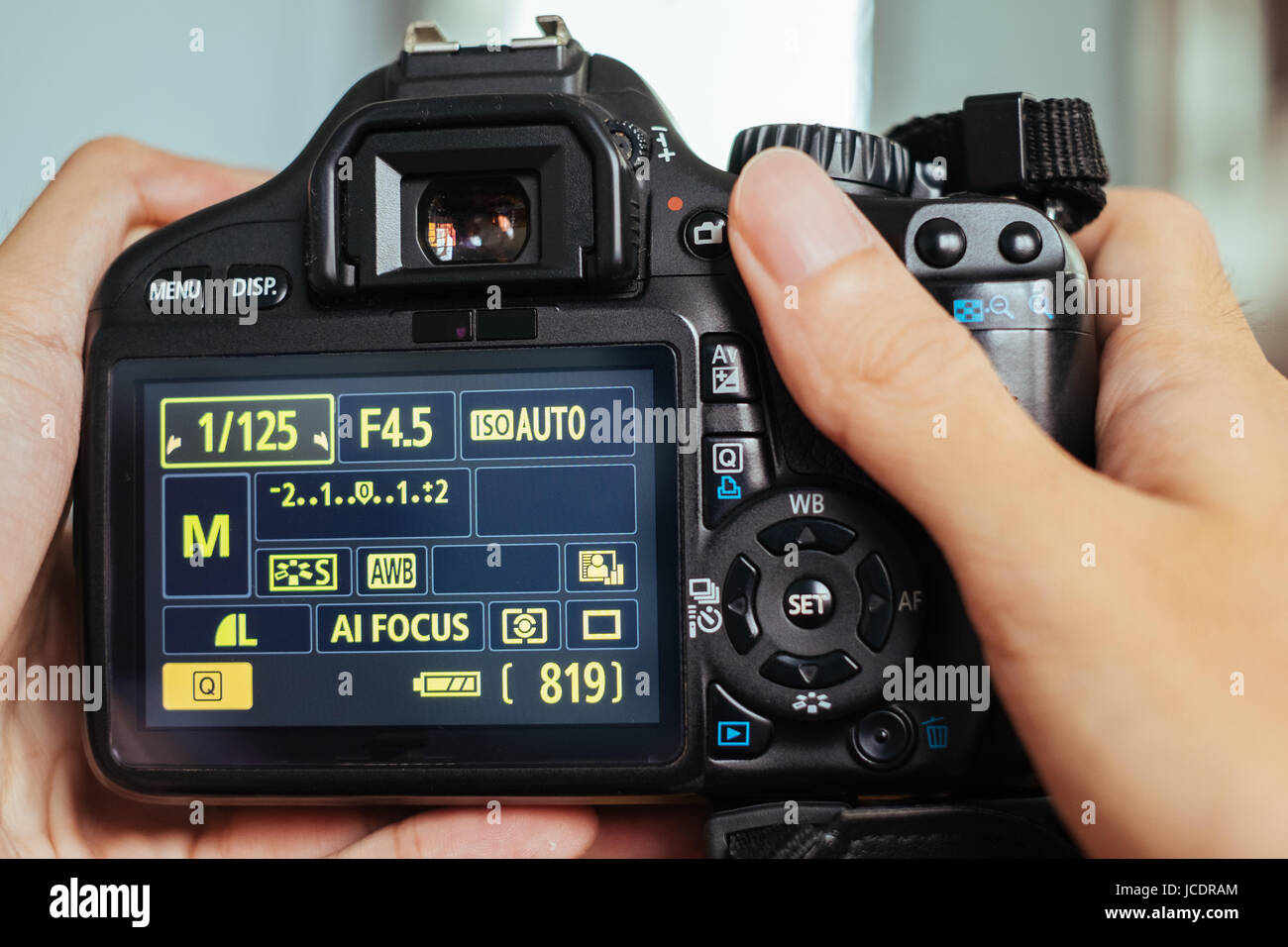 DSLR camera on human hands - Stock Image