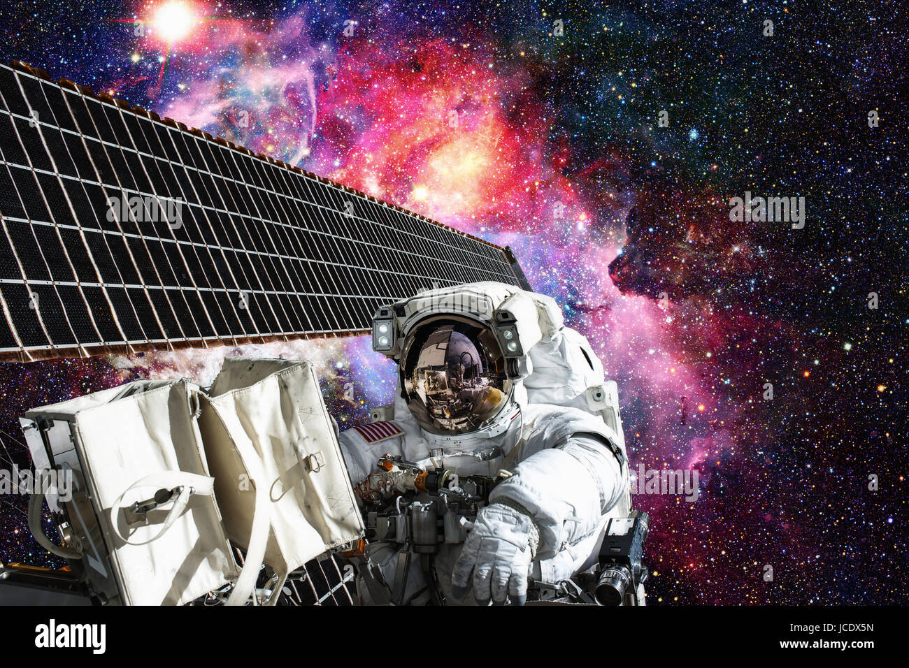 Cosmonaut works outside the International Space Station. Elements of this image furnished by NASA. - Stock Image