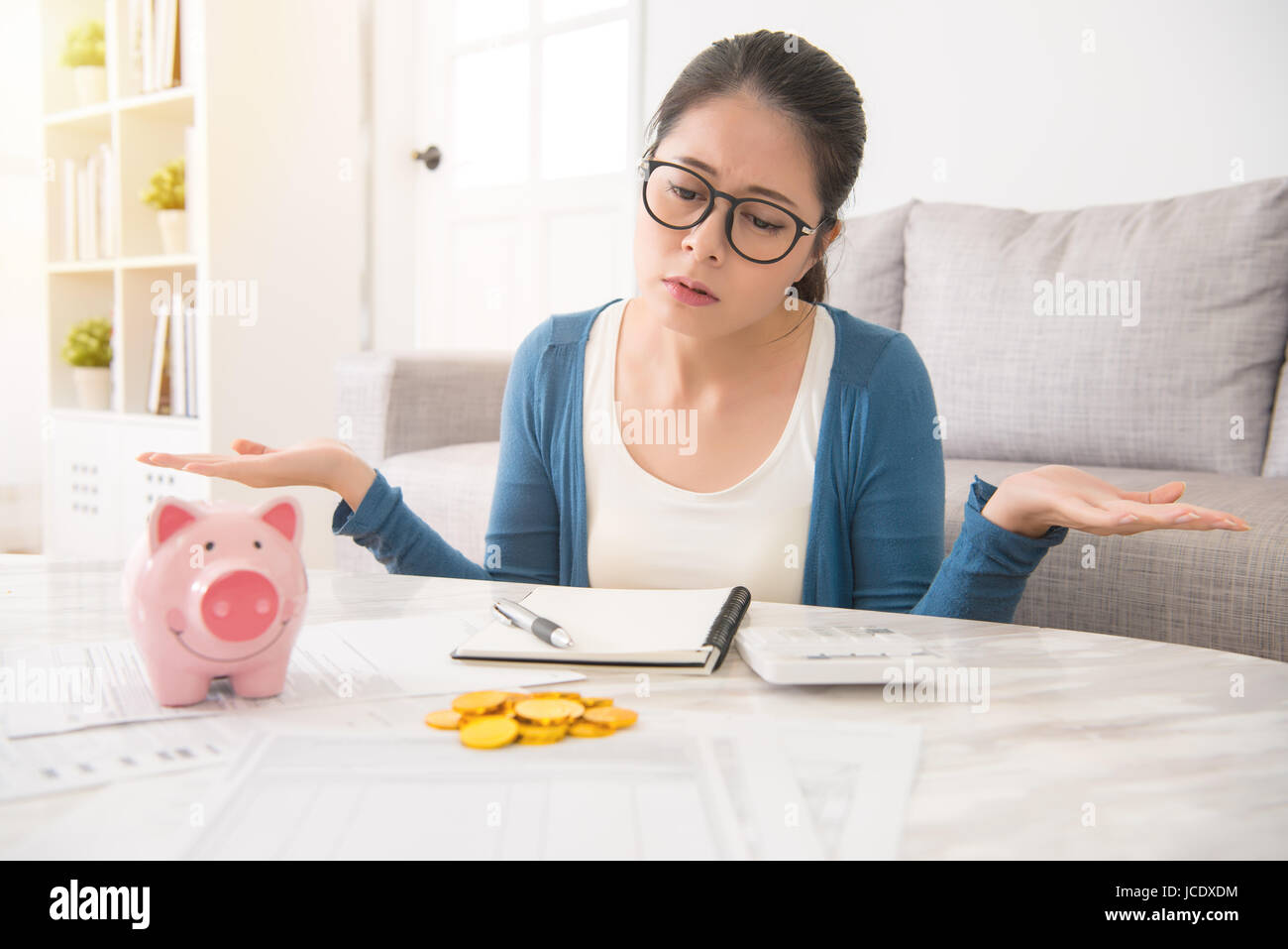 helpless young asian chinese woman having financial problems sitting