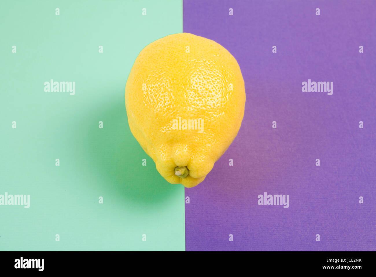 Pop minimal still life photography. lemon isolated on a Pop minimal still life photography. Lemon yellow isolated - Stock Image