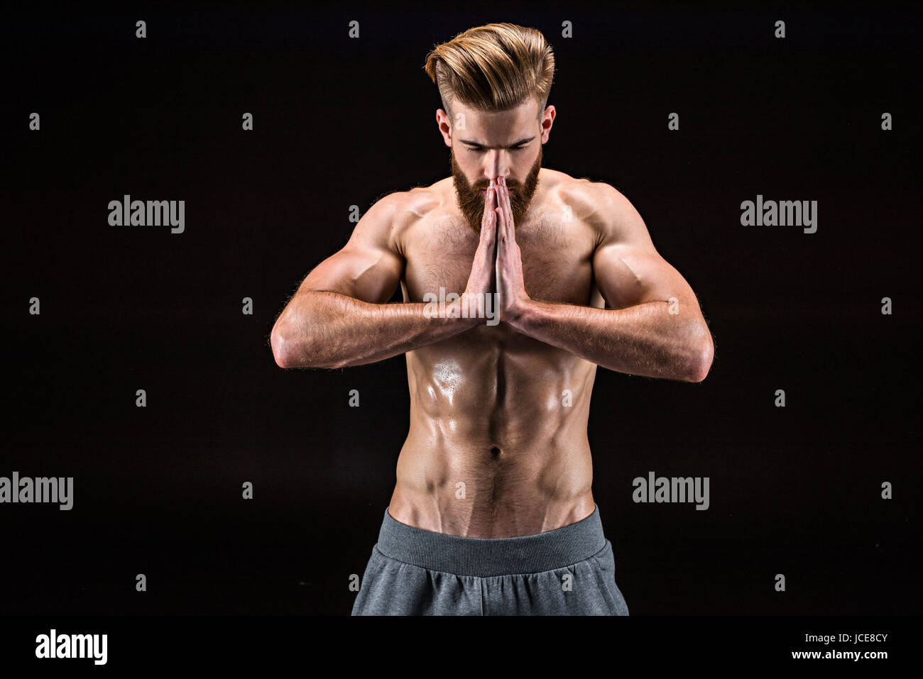 Man In Yoga Pose With Namaste Gesture In Relaxation Yoga Classroom