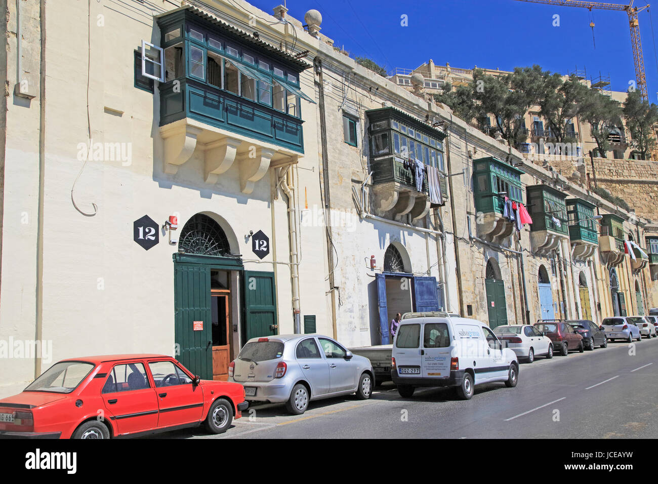 Old merchant house with balcony above warehouse area, Valletta, Malta Stock Photo