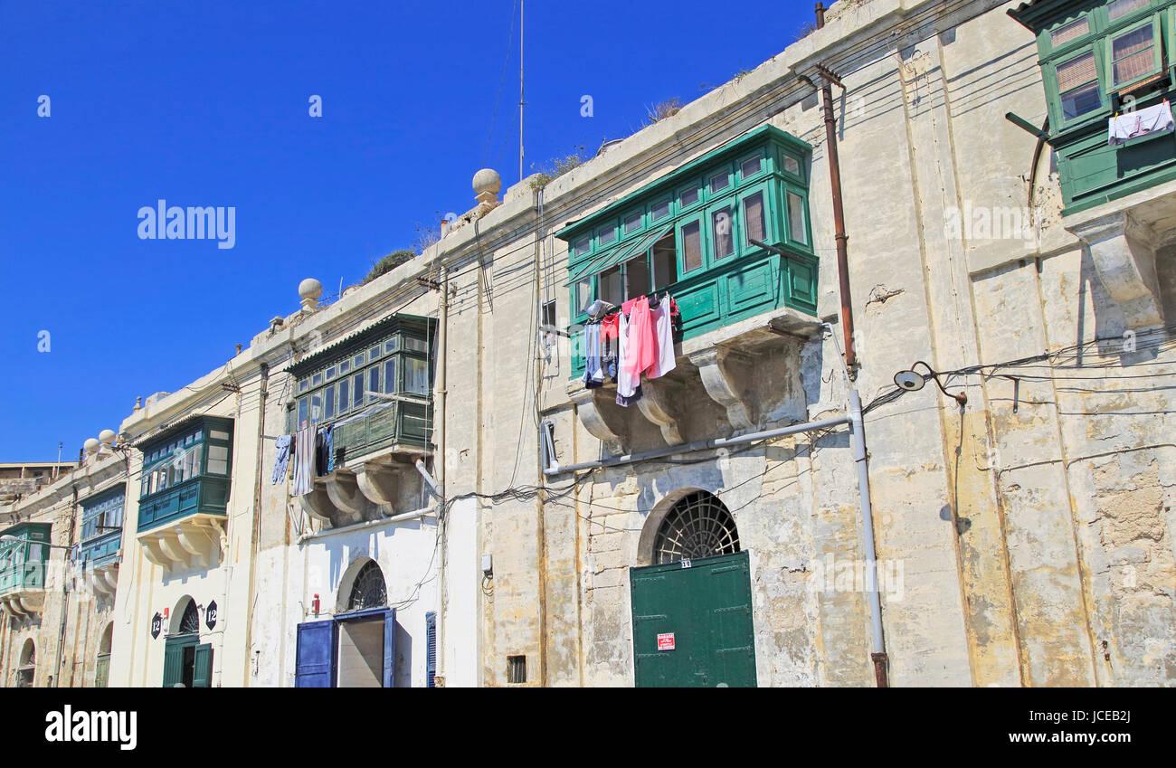 Old merchant house with balcony above warehouse area, Valletta, Malta Stock Photo