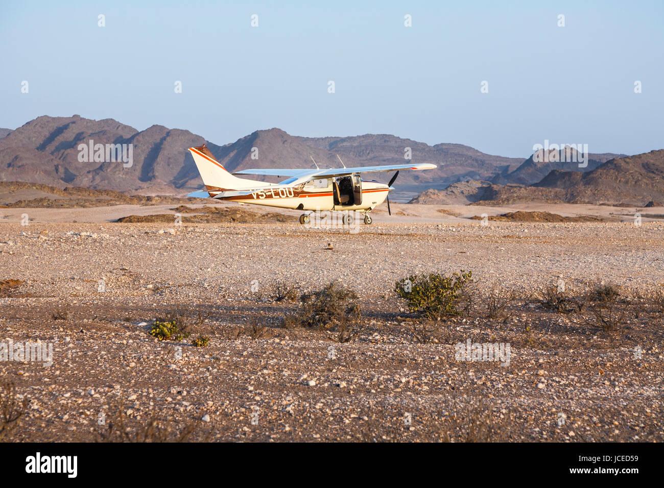 Cessna 210 Centurion II on the ground, landed in the arid Namib Desert Namibia, Skeleton Coast, south-west Africa; - Stock Image