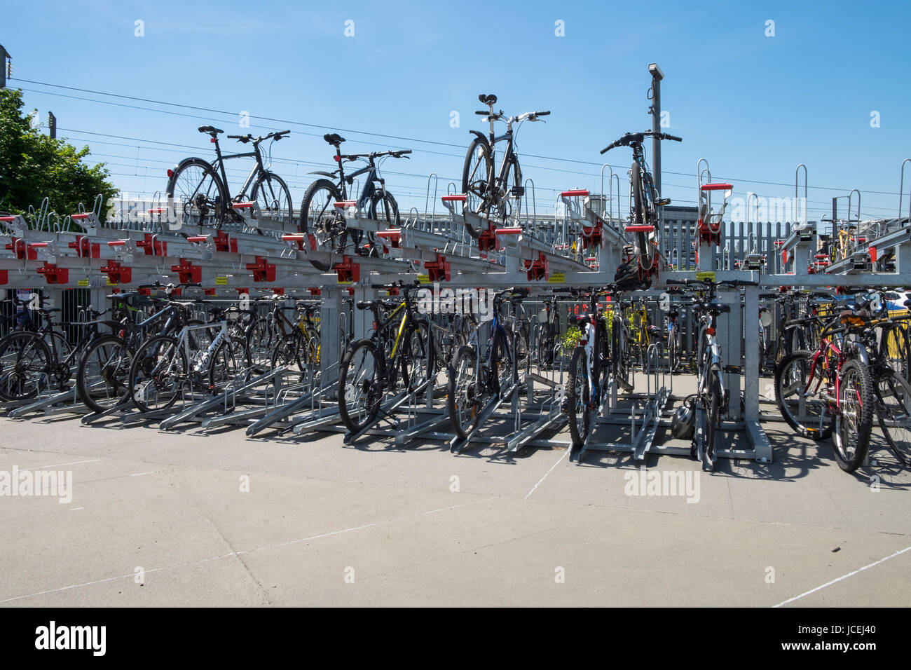 Bike cycle hub secure parking located at Ashford train station, uk - Stock Image