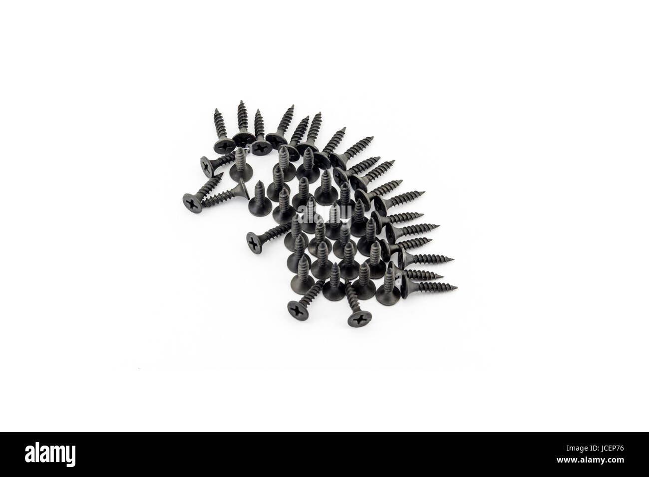 Hedgehog laid out withblack Oxidized self-tapping screw isolated on white background - Stock Image