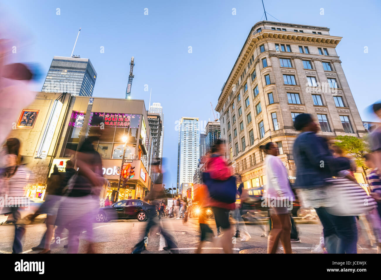 Montreal, 9 June 2017: Motion blur image of people walking on ste Catherine street during grand prix weekend. - Stock Image