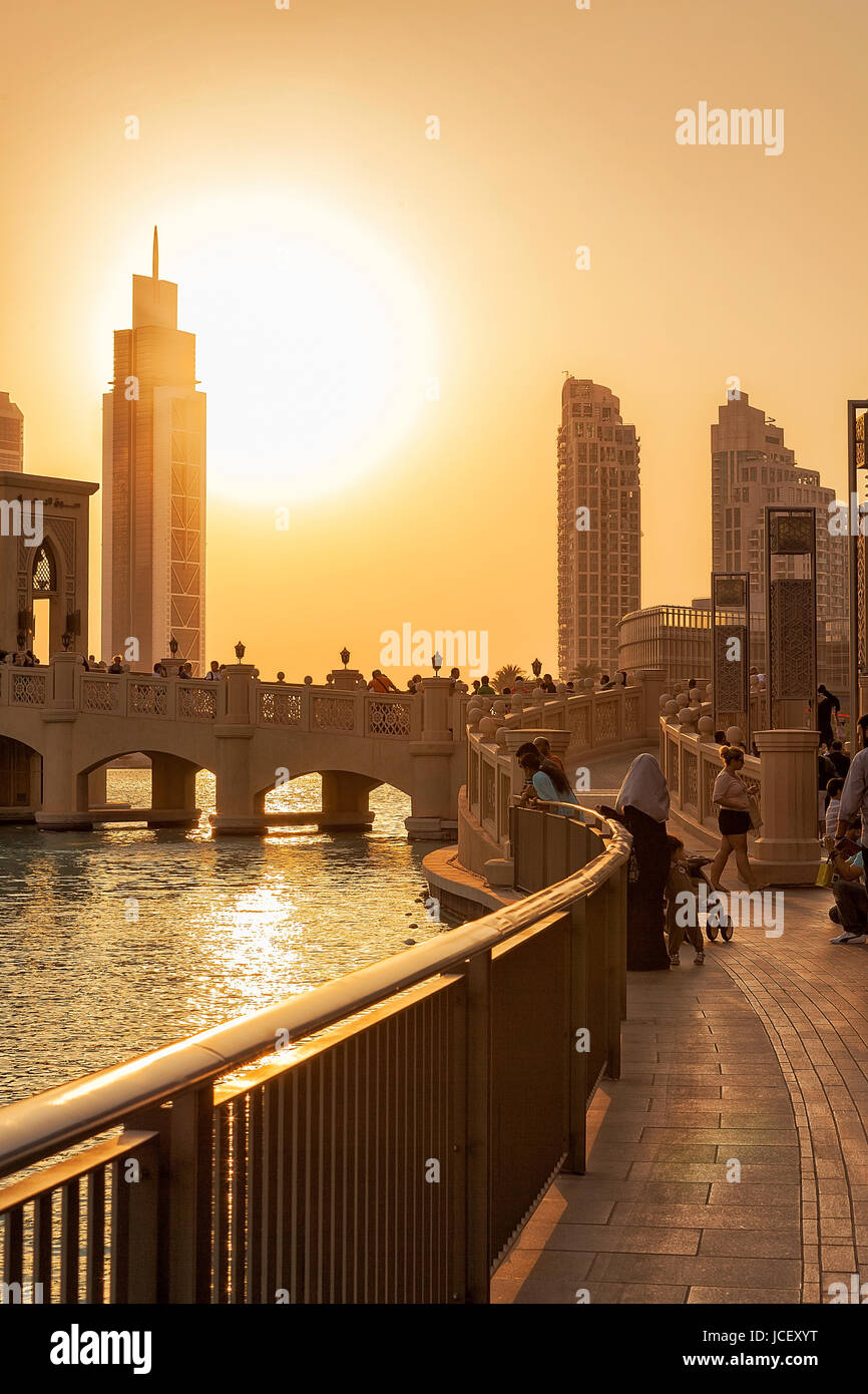 UAE/DUBAI - 14 SEP 2012 - People relaxing on the streets of dubai with sunset Stock Photo