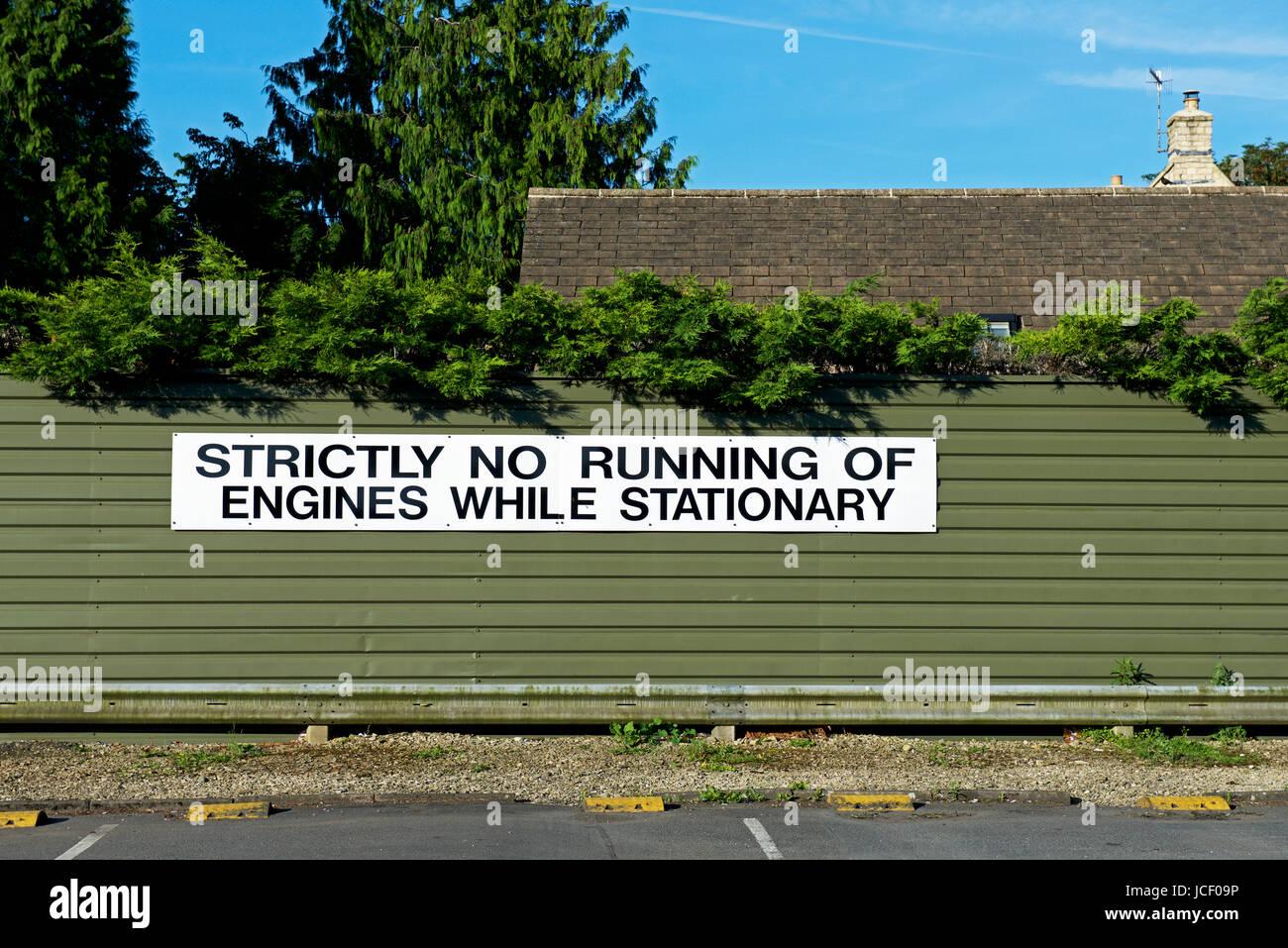 Sign - strictly no running of engines while stationary - England UK - Stock Image