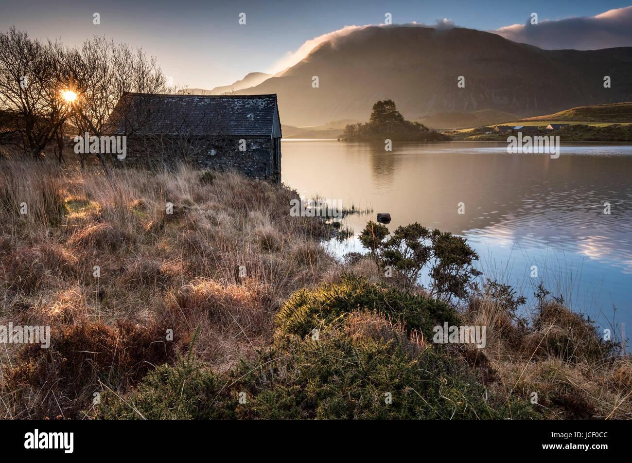 Dawn at Cregennan Lakes backed by Cadair Idris, Snowdonia National Park, Gwynedd, North Wales - Stock Image