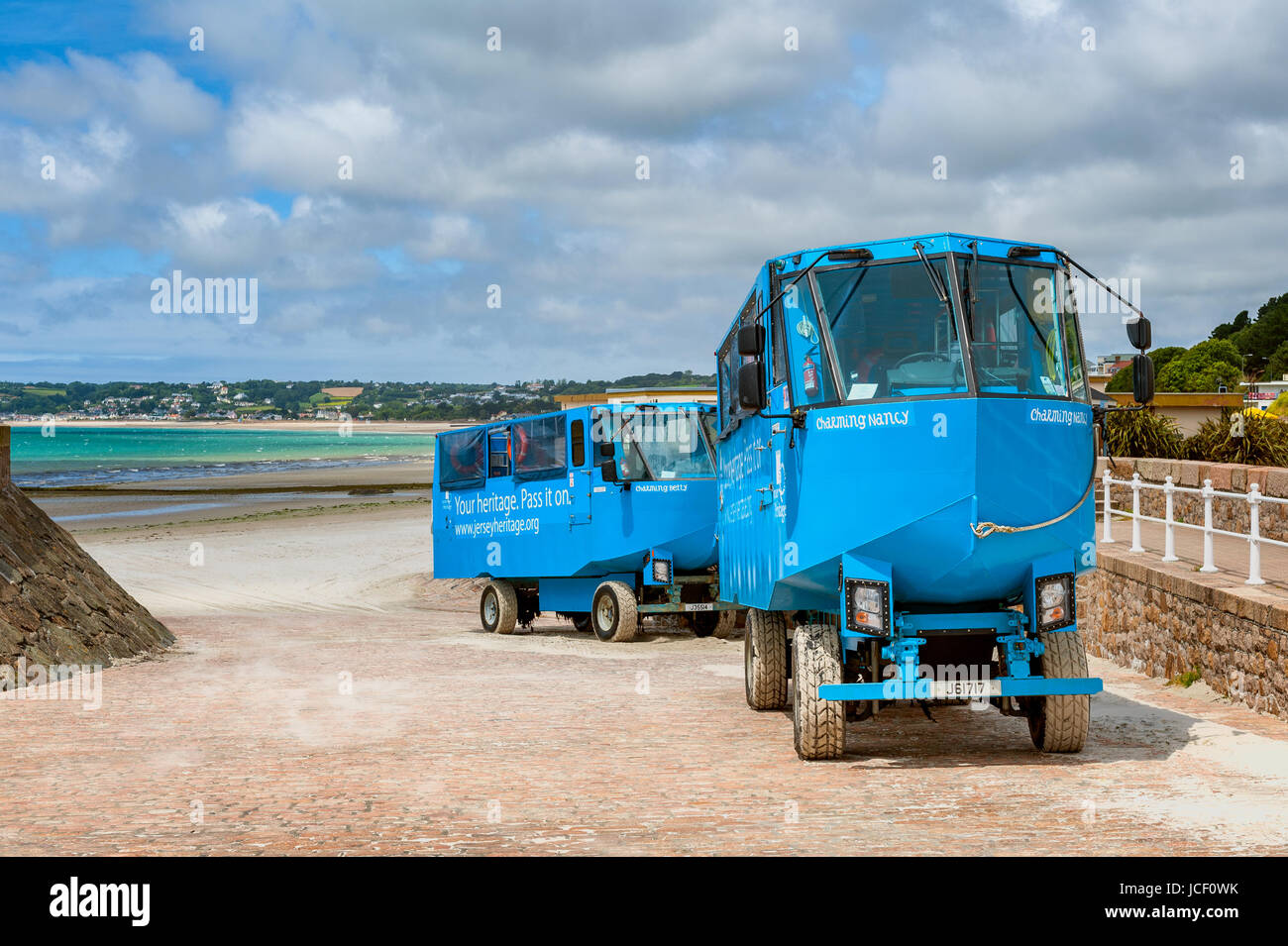 Amphibious vehicles on the beach of St. Helier, Jersey, UK. They are used to transport tourists to Elizabeth Castle - Stock Image