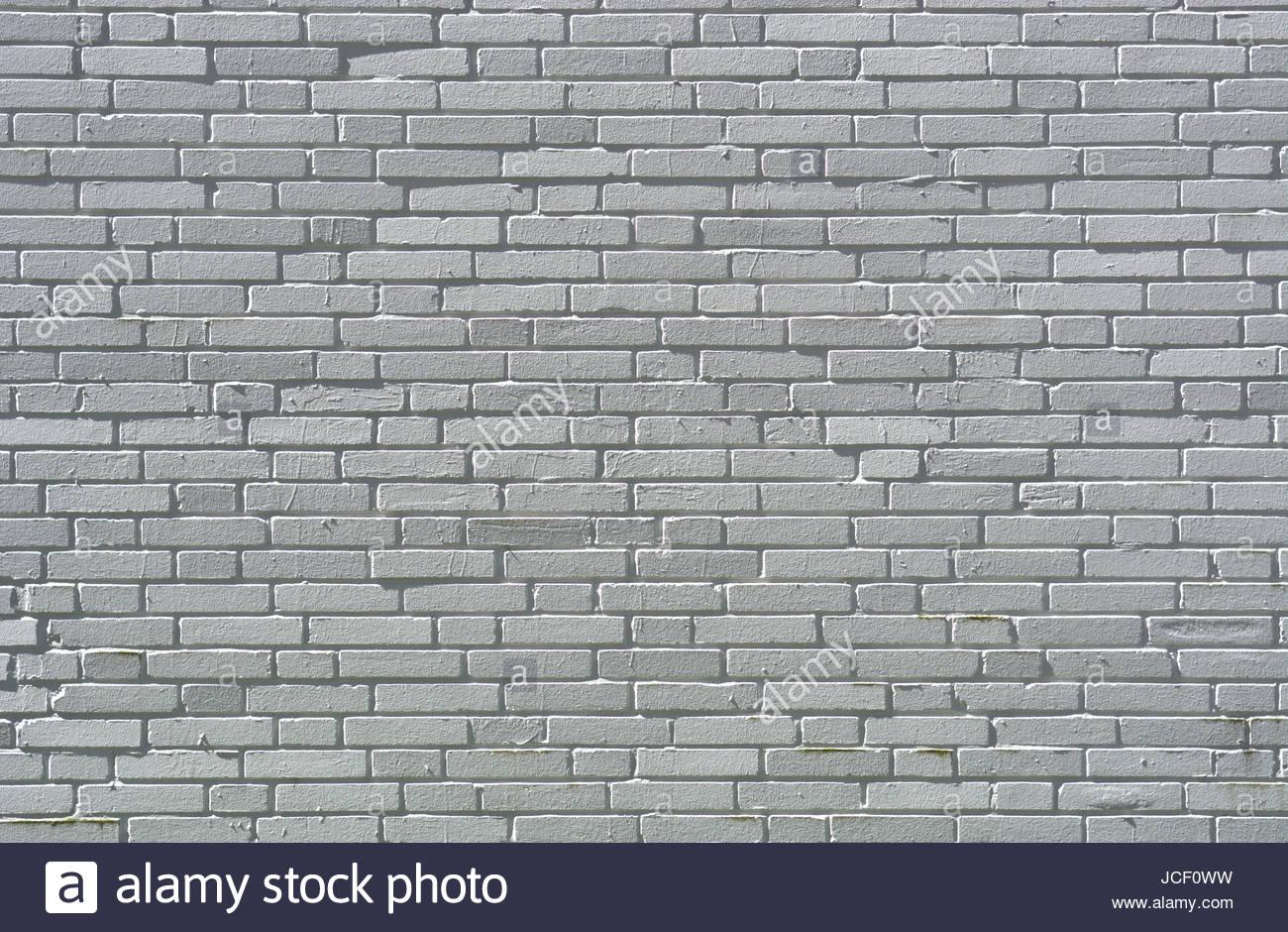 Alte, unregelmäßige, weiße Klinkersteine im Mauerwerk einer Hauswand mit Fugen. - Stock Image