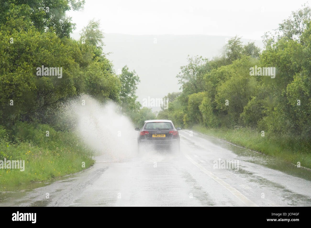 Mugdock, Stirling, Scotland, UK. 15th June, 2017. UK weather - surface water on roads during a heavy afternoon shower - Stock Image