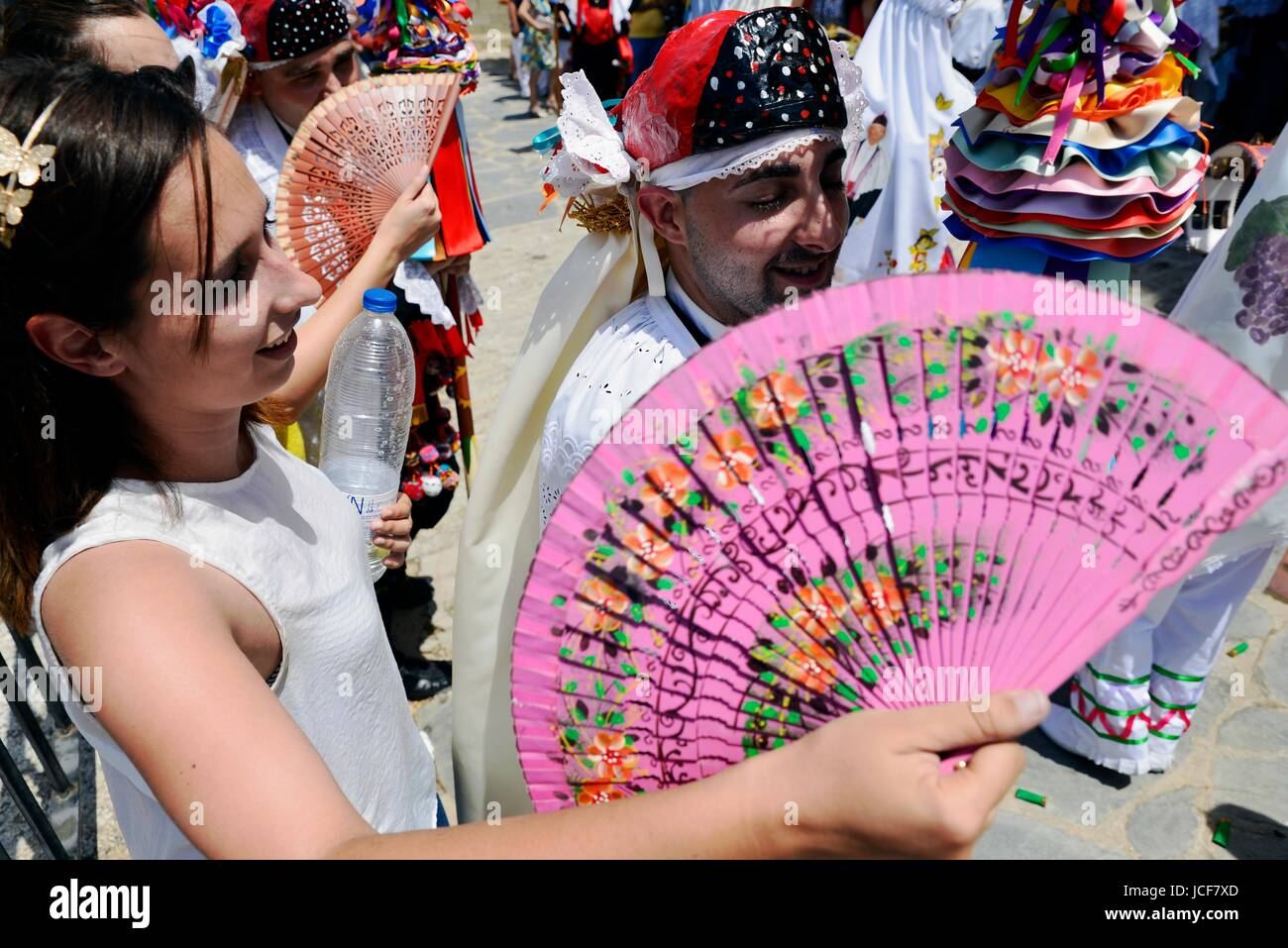 Camunas, Toledo, Spain. 15th June, 2017. A young woman gives air to a participant in the procession of the Corpus - Stock Image