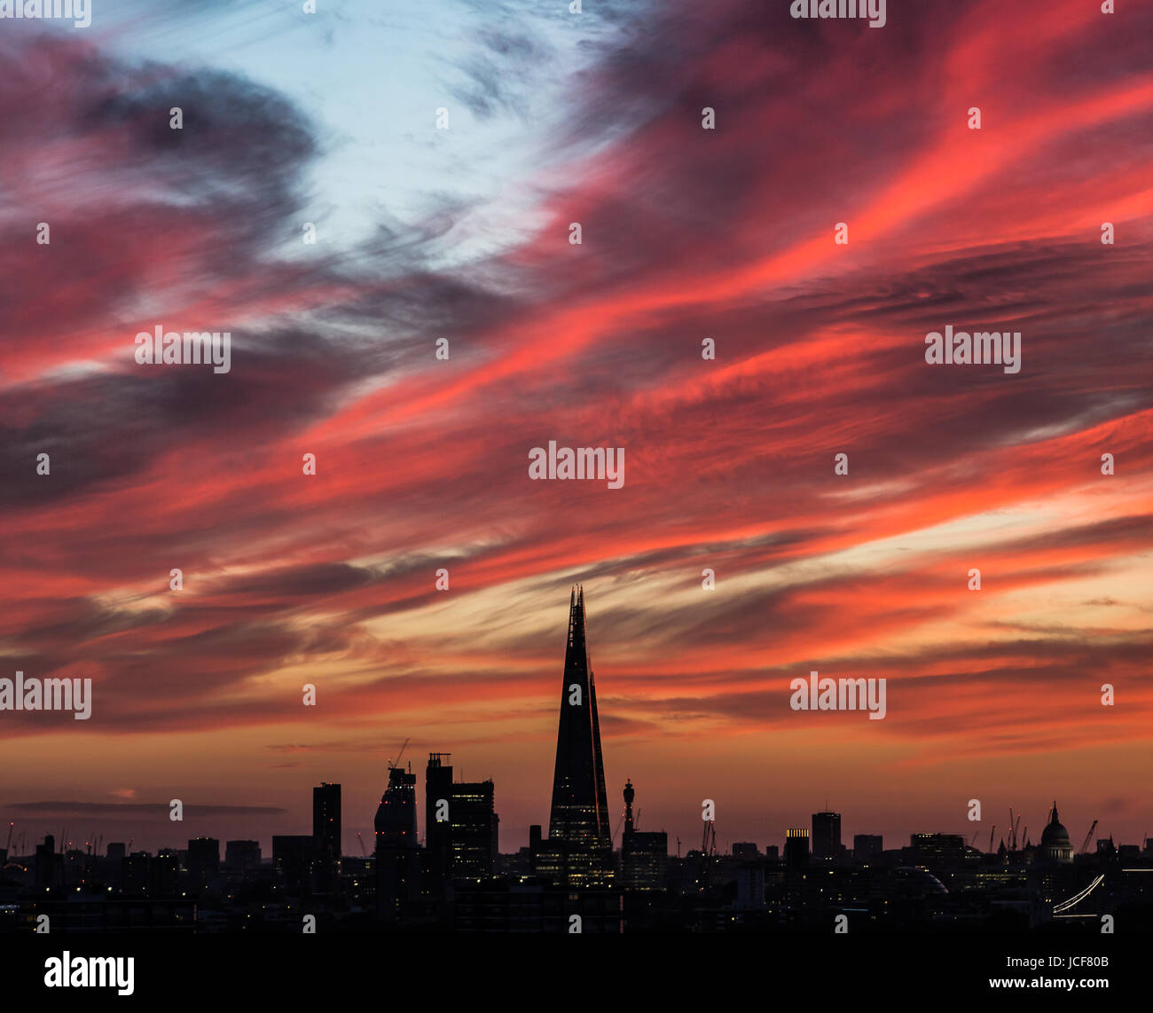 London, UK. 15th June, 2017. UK Weather: Evening sunset over the city including The Shard skyscraper building. Credit: Stock Photo